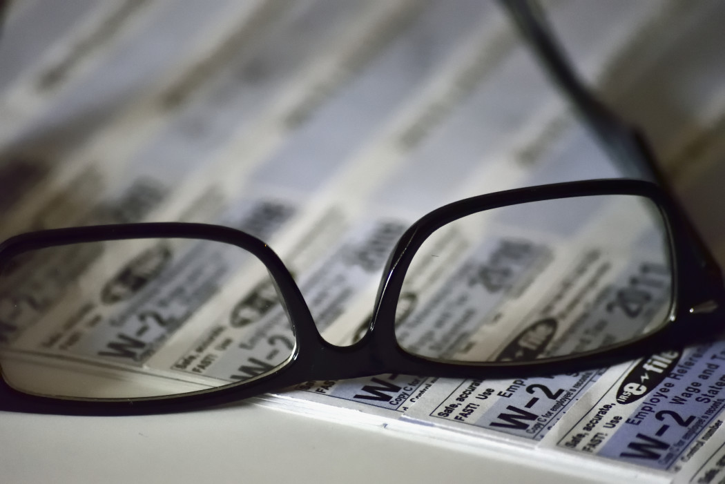 charlotte state bank & trust tax scams reading glasses on tax form